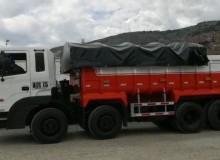 Autocarpado de fuelle camion cuatro manos